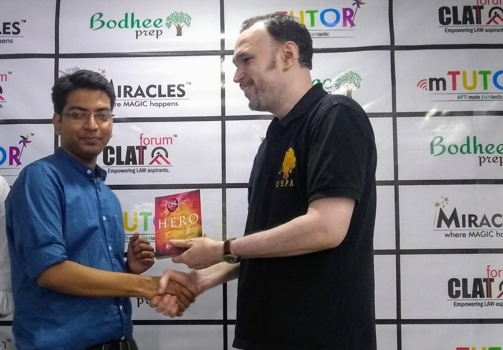 Shyam Verma presenting a Book to Digvijay
